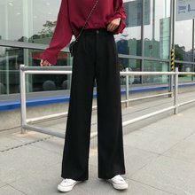 Женские офисные брюки с широкими штанинами черные повседневные
