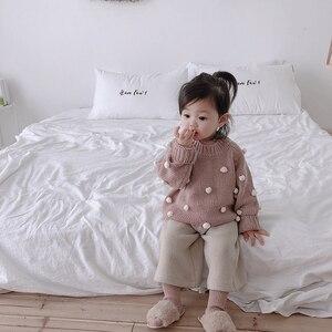 Image 3 - Nữ Thu Đông Áo Thun Cổ Áo len tập đi cho bé Quần áo litttle 3D bi tay dài bé áo len trẻ em Nón kết nam nữ 1 5T