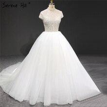 الأبيض البريق قصيرة الأكمام تول فساتين الزفاف 2020 عالية الرقبة الترتر الخرز زي العرائس HA2280 مخصص