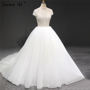 Image 1 - White Sparkle Short Sleeve Tulle Wedding Dresses 2020 High Neck Sequins Beading Bridal Gowns HA2280 Custom Made