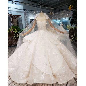 Image 1 - BGW HT5610 Luxury Swollen Wedding Dresses With Detachable Special Cape Illusion Back Luxury Handmade Ball Gown Wedding Gown 2020