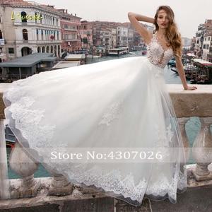 Image 3 - Loverxu ilusão colher bola vestido de casamento vestidos chiques apliques boné manga botão vestido de noiva tribunal trem vestidos de noiva mais tamanho