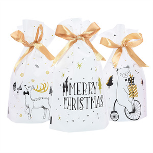 Image 1 - 5pcs Merry Christmas Candy Bag Plastic Drawstring Bags Silk Ribbon For Birthday Wedding Party Decora Kids Gift Wrapping Supplies