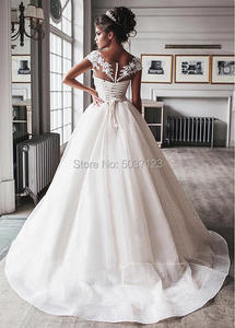 Image 2 - Luxury Bling Ball Gown Wedding Dresses 2021 Nude Tulle Neck Cap Sleeves Lace Applique Corset Buttons Sweep Train Bridal Gowns