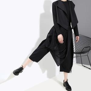 Image 5 - [EAM] pantalones asimétricos negros a rayas con cintura elástica alta, nuevos pantalones holgados ajustados para mujer, tendencia de moda para primavera y otoño 2020 1A933