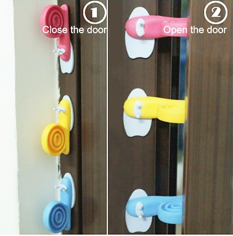 Plastic Baby Safety Door Stopper Protector Children Safe Snail Shape Door Stop