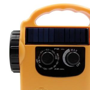 Image 5 - Portable Solar Powered AM/FM Radio with LED Flashlight Electronics Dynamo Automotive Hand Crank Emergency Camping Power Bank