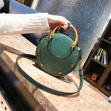 Rivet small round bag lady new fashion handheld Korean version Baitao one shoulder inclined Bay handbags