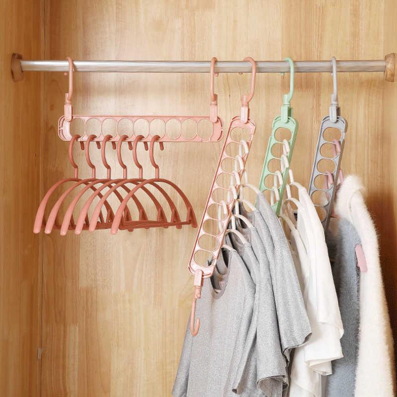 Nueva llegada nueve agujeros giratorios colgador mágico multifunción plegable colgador gancho armario secado ropa ahorro de espacio