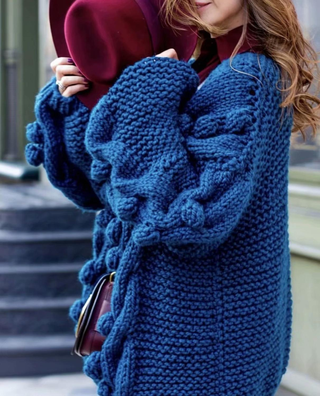 Ganchillo hecho a mano chaqueta suéter en otoño e invierno