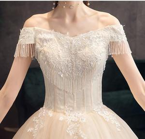 Image 5 - Klasyczny szampan 2019 nowa suknia ślubna elegancka łódka szyi Off The Shoulder koronkowe koralikowe frędzelki Slim Ball suknia Robe De Mariee