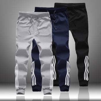 Wiosna jesień mężczyźni spodnie dresowe na co dzień 2020 mężczyzna odzież sportowa biegaczy paski spodnie moda mężczyzna Skinny blisko dopasowane siłownie Harem Pants tanie i dobre opinie MANTORS Wysoka Mieszkanie Poliester Kieszenie REGULAR Casual Men Sweatpants Joggers Pants Male pants masculino Midweight
