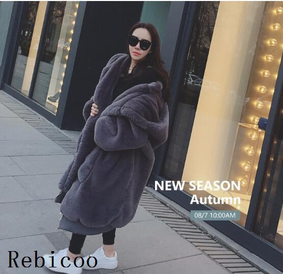 New Plus Size Winter Coats Women Solid Color Casual Loose Fur Jacket Big Fur Hooded Overcoats Fashion Thicken Faux Fur Coat