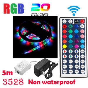 Image 1 - 5 מטר ללא עמיד למים גמיש צבע שינוי RGB SMD3528 300 נוריות רצועת אור + חדש 44 מפתח מרחוק בקרת 12V + 2A אספקת חשמל