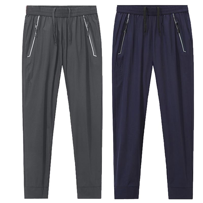 Big size L~8XL summer men`s Ice silk fabric sports sweatpants Slim Stretch Loose pant men Military Waterproof Quick Dry trousers