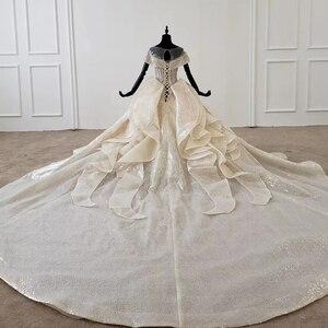 Image 2 - HTL1137 błyszcząca suknia ślubna nakryty rękawem o neck zasznurować gorset suknie ślubne wzburzyć pociąg ins gorąca sprzedaż świecący vestidos novia