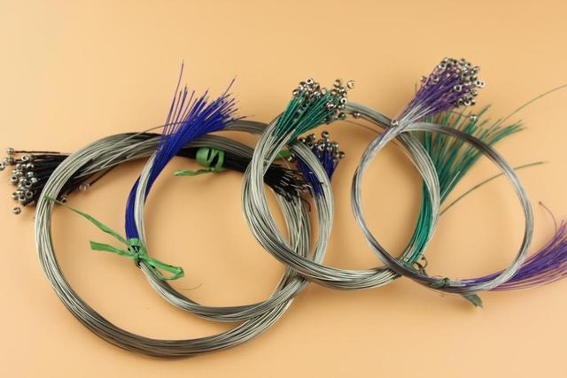 300 ensembles de cordes de violon de taille 3/4-4/4, enroulé argent allemand. Accessoires de pièces de violon
