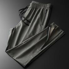 Мужские брюки на молнии Minglu, модные водонепроницаемые штаны с эластичной резинкой на талии для отдыха и спорта, брюки размера плюс 4XL