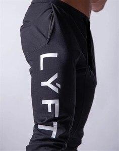 Image 1 - 2020 New Jogging Men Sport Sweatpants Running Pants GYM Pants Men Joggers Cotton Trackpants Slim Fit Pants Bodybuilding Trouser