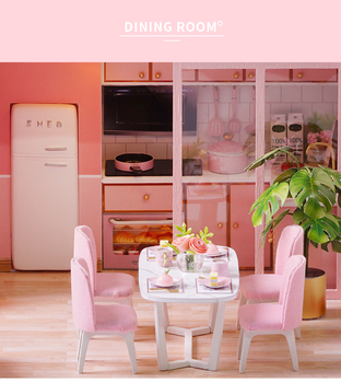 kitchen view of the pink doll house. table and chairs, oven