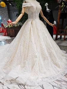 Image 4 - BGW HT43026 2020 חדש חומר חתונת שמלות עם ארוך רכבת כבוי כתף מתוקה יוקרה שמלת כלה עם מבריק פאייטים