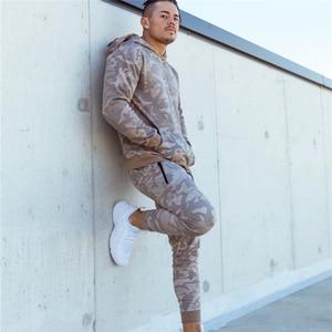 Image 4 - 2019 Autumn Winter Running Set Men Sport Suits Hoodies Pants Sets Sweatshirt +Sweatpants Sportswear Gyms Fitness Tracksuit Male