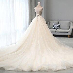 Image 2 - מבריק חרוזים קריסטל גוף נסיכת חתונה שמלות אונליין Vestido Noiva כתף רצועות ללא משענת כלה אשליה