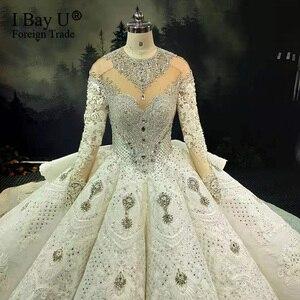 Image 4 - 100% תמונה אמיתית יוקרה בלינג 3D אבנים חתונת שמלה ארוך שרוולים 2020 קריסטל כדור שמלה נפוחה 180cm רכבת