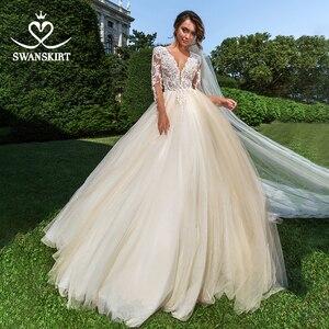 Image 1 - Vintage perles Appliques robe de mariée swanjupe F104 col en v à manches longues a ligne dentelle princesse robe de mariée Vestido de novia