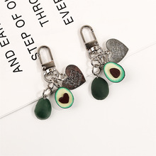 цены на New Simulation Fruit Avocado Heart-shaped Headphone cover keychain car Fashion keyring Jewelry Gift For Women  в интернет-магазинах