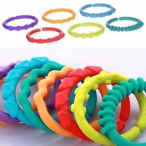 24 шт./лот детские игрушки-прорезыватели красочные кольца радуги детские погремушки для мобильных телефонов кроватки, коляски, подвесные ук...