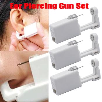 3 sztuk jednorazowe sterylne urządzenie do przekłuwania uszu do małżowiny ucha Helix Piercing Gun bez bólu Piercer narzędzie zestaw maszyn Stud #8230 tanie i dobre opinie CN (pochodzenie) STAINLESS STEEL Plug tunnel biżuterię TRENDY ROUND Metal Nose Piercing Gun 20G(0 8mm) 15g box 1pc nose gun box containing nose ring and 1pc alcohol cotton