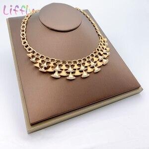 Image 2 - Комплект ювелирных изделий в нигерийском стиле, золотой цвет, свадебный кристалл, Дубай, Ювелирные наборы для женщин, ожерелье, серьги, браслет, кольцо, набор