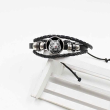 цена Europe and the United States new black and white tiger bracelet crystal glass woven leather retro jewelry gift в интернет-магазинах