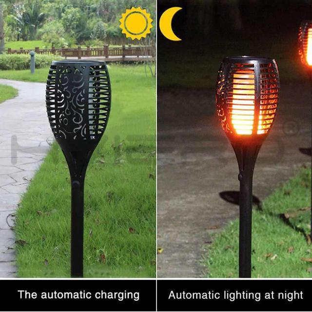 светодиодный светильник с пламенем на солнечной батарее водонепроницаемый фотография