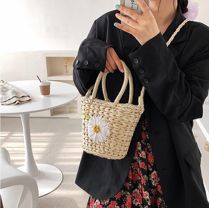 Woven Small Size Straw Tote Bag with Shoulder Strap and Flower Pattern.