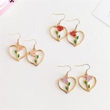 Fashion simple red roses dangle earrings Retro metal heart pendant earrings rose fine jewelry roses eardrop earrings for women scott rheuben roses are not red
