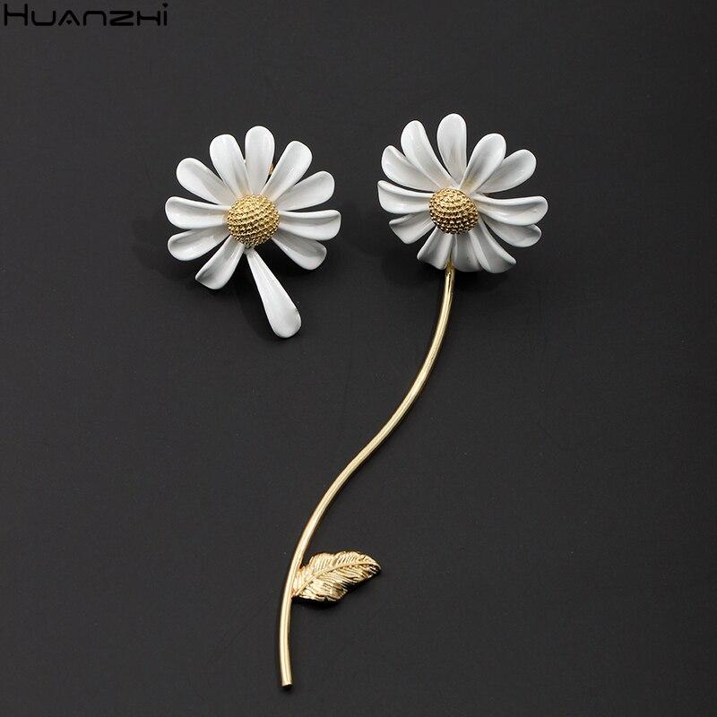 Новинка 2020, весенние Асимметричные висячие серьги HUANZHI с глазурью и кисточками в виде цветка маргаритки, милые металлические Висячие серьги...