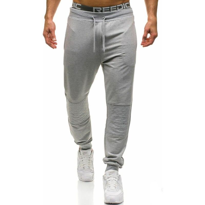 Pantalon de couture rhombique décontracté pour hommes d'été nouveau pantalon de taille européenne et américaine mince pour hommes