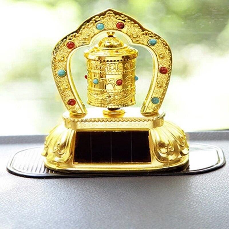Adorno de coche energía Solar creativa Budista Tibetano rueda de oración religiosa aleación de Zinc + resina Auto interior símbolo de seguridad Decoración Estatua de carácter abstracto accesorios de decoración del hogar creativo ornamento del hogar sala de dibujo Oficina arenisca estatua decoración figurita