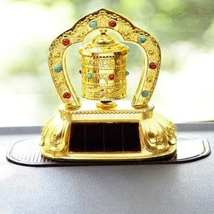 Car Ornament Creative Solar Energy Buddhist Tibetan Prayer Wheel Religious Zinc Alloy+Resin Auto Internal Safety Symbol Decor(China)