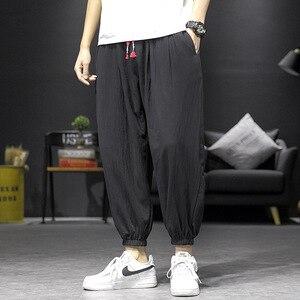 Pantalones cruzados de primavera y verano para hombre, ropa informal japonesa informal holgada de algodón y lino, pantalones de baile de hip hop, ropa coreana para hombre