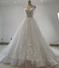 Spaghetti Straps Shinning Tulle Ball Gown Luxury Wedding Dresses Chapel Train Unique Lace Appliques Gowns