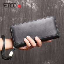 AETOO Crazy horse leather men's handbag, stylish high-capacity one-shoulder stiletto bag, leather computer bag.