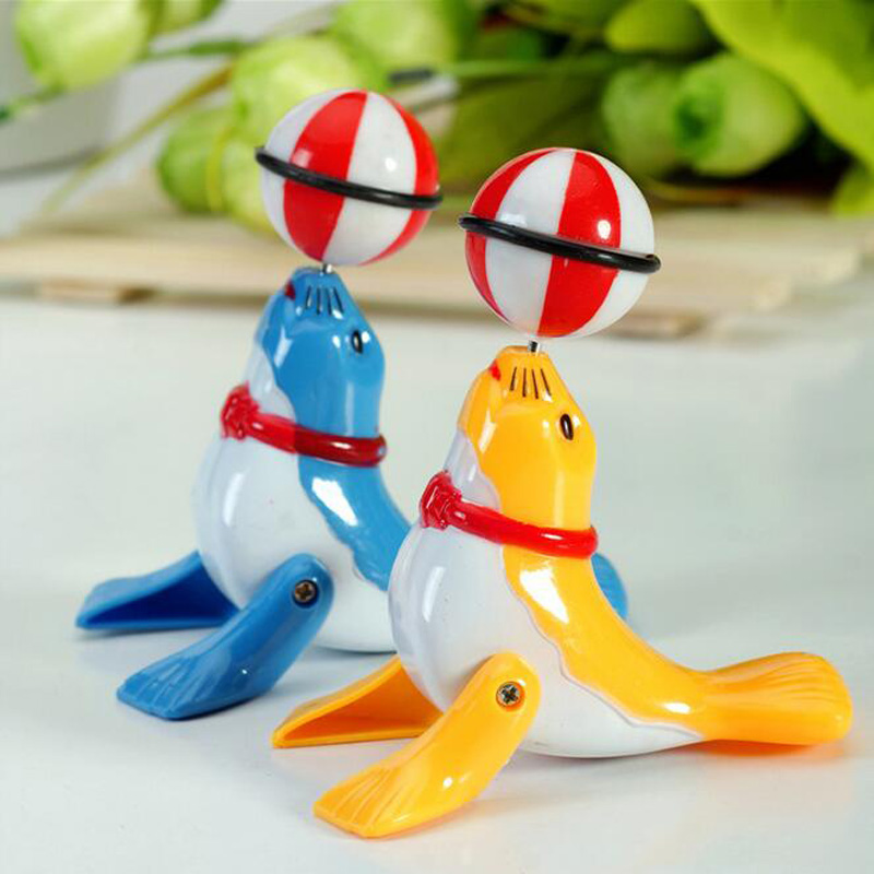 1pc Cute Clockwork Chain Cartoon Dolphin Sea Lion Wind-up Kids Educational Toys for Children Plastic Model Funny Games Boys Girl(China)