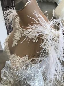 Image 2 - Liyuke Luxury Ostrich Feather Mermaid Wedding Dress Scoop Neckline With Sleeveless Chaple Train Bridal Dress
