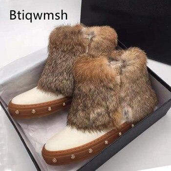 Botas de nieve de piel 2019 de lana para mujer, zapatos planos con remaches de punta redonda y diseño lujoso, botines cálidos de moda para mujer para invierno