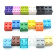 100 adet/grup 2X2 * DIY Enlighten oyuncak plastik yapı taşı tuğla ile uyumlu çocuklar için Legoe toplama parçacıklar 12 renk