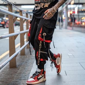 Listowe wstążki Casual joggersy hip hopowe spodnie Cargo dla mężczyzn Block hit kolorowy kieszonkowy spodnie do biegania męskie spodnie dresowe Streetwear tanie i dobre opinie GUYI Cargo pants Mieszkanie COTTON Poliester REGULAR 24 41 - 31 71 Pełnej długości M19PT0114 Midweight Suknem Sznurek