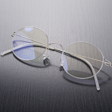 Pure Titaniumไม่มีสกรูน้ำหนักเบาแว่นตาผู้ชายผู้หญิงแว่นตาRetro Roundกรอบแว่นตาซิลิโคนNose Pads